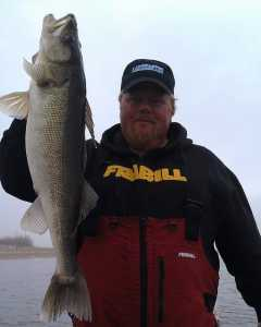 Bro with walleye on Rainy River